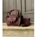 Leather bag purse made by polish designers from ladybuq art in plum and black colours