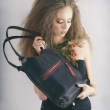 black original bag with antique gold leather fittings, zippered pocket and long shoulder strap
