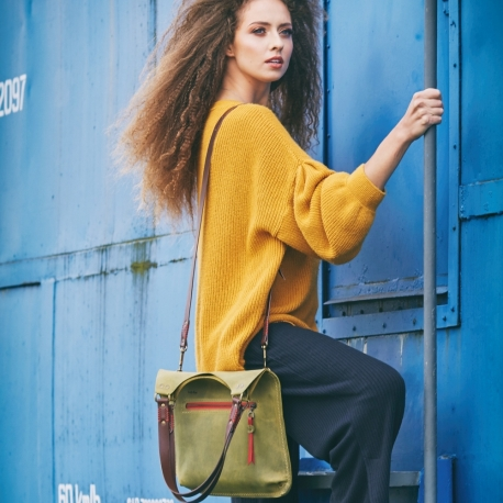 beautiful small ladybuq bag with handstitched straps in lime colour