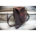 small bag in beautiful brown colour with red accents zippered pocket and long strap