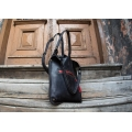 black original bag with antique gold leather fittings, zippered pocket and long shoulder strap