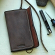 leather wallet closed with a strap with original orange zipper made by ladybuq