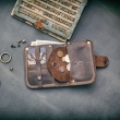 small brown wallet with coin pocket closed with a nap made by ladybuq