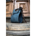 bag in unique shape with long, detachable strap, formal bag to work or for everyday use