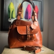 Alicja Purse with small exterior buckle closure pocket in Ginger color