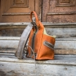 Leather handmade backpack or shoulder bag in Orange and Lime colors made by Ladybuq