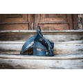 leather backpack in navy blue color with comfortable zippered pocket on the back