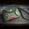 small key case made out of natural leather in Khaki color