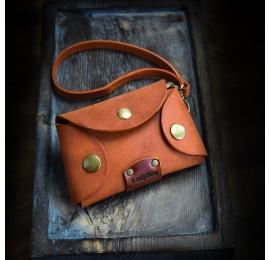 Handmade leather key holder in Orange color with wristlet strap