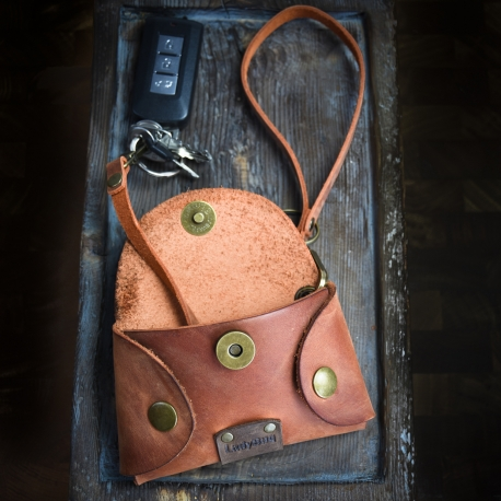 small leather key case in ginger color made by Ladybuq