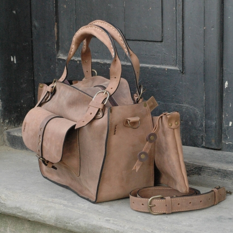 kuferek bag made out of highest quality natural leather with a clutch, strap and big exterior pocket light brown