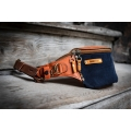 Small leather fanny pack in Orange and Navy Blue colors with ornamental dots and comfortable hip strap