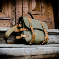Handmade leather backpack made out of natural leather in Khaki and Camel color with additional shoulder strap