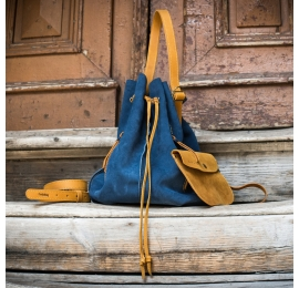 small purse made out of suede leather in blue color, comfortable handbag or crossbody bag