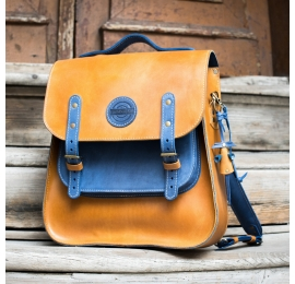 Leather backpack with shoulder strap and comfortable handle in Camel and Blue color variation made by Ladybuq