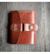 Multifunkctional wallet in ginger color made of natural leather