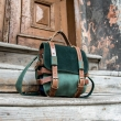 Original oldschool leather backpack in green color with comortable pocket on the back and long strap
