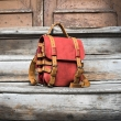 Original oldschool leather backpack in Red color with comortable pocket on the back and long strap