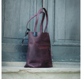 Zuza made out of matt leather in Plum colour, bag with magnet closure and zippered exterior pocket made by Ladybuq Art