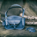 Kuferek with interior and exterior pocket in navy blue colour with long shoulder strap by Ladybuq