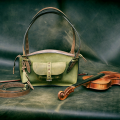 Leather bag in Lime colour made by Ladybuq Art with additional long strap