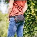 black leather wallet with long shoulder strap and spot for your phone