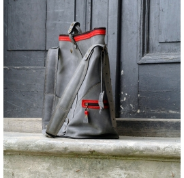 Travel bag and biker backpack made out of Grey matte natural leather with Red accents made by Ladybuq Art Studio