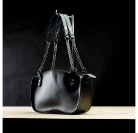 Original handmade leather bag in black colour with chain on a strap made by Ladybuq Art